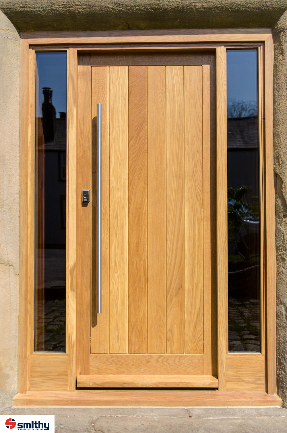 Contemporary oak doors an casing with glass lights either side.