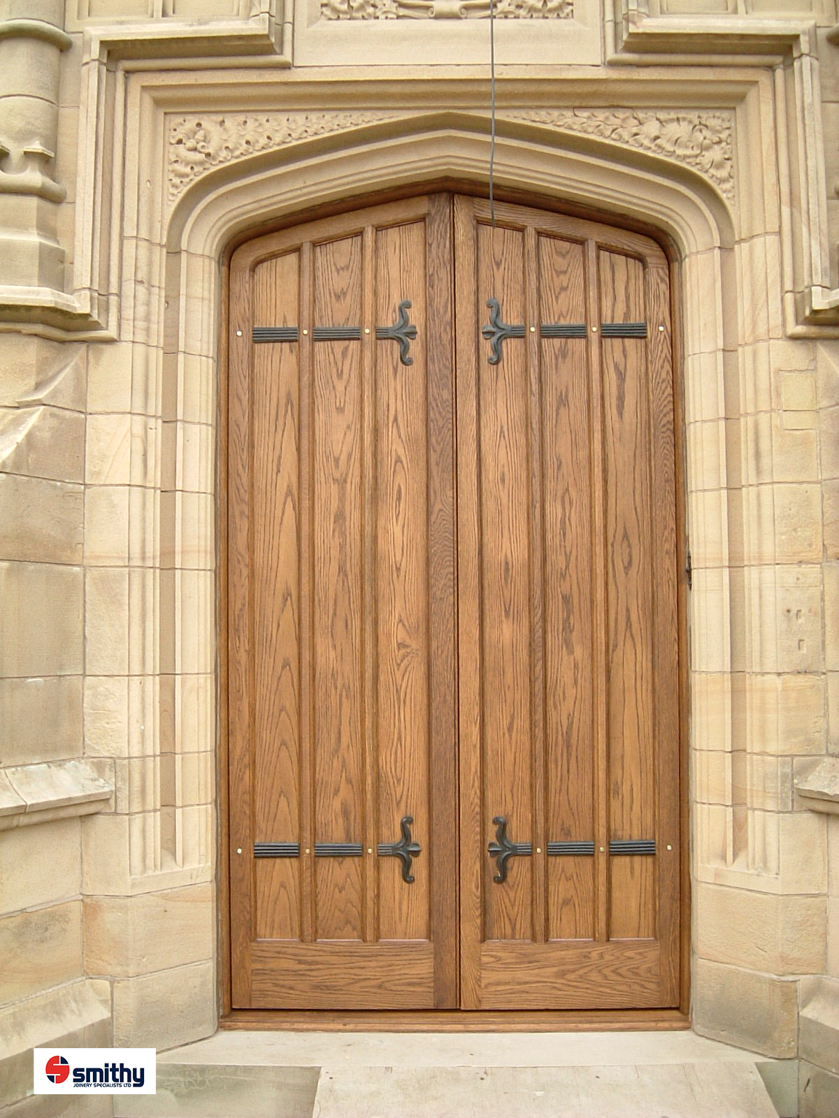 Oak gothic doors for stately home.