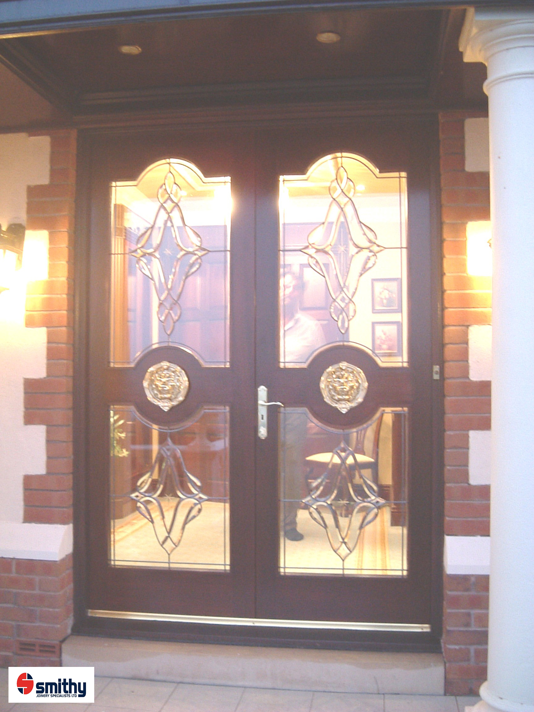 Bespoke front doors made from Sapele hardwood with glass lead design and lions head door knockers.